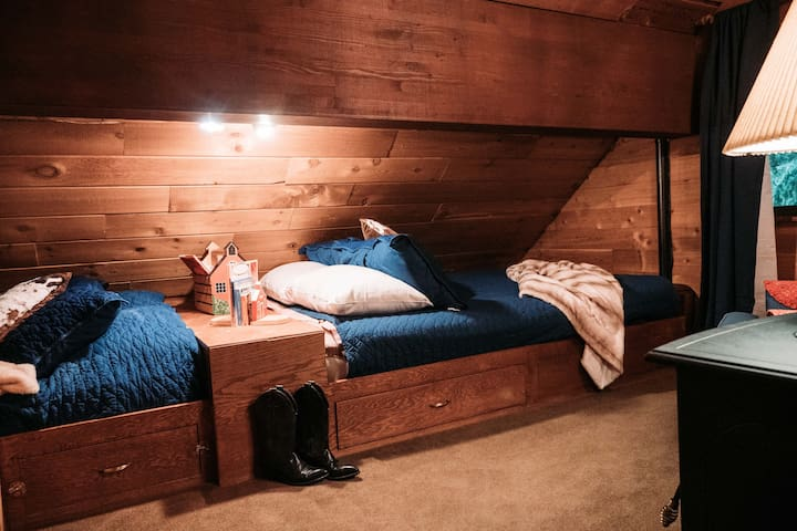 Loft bedroom #1 with a queen and a double bed.