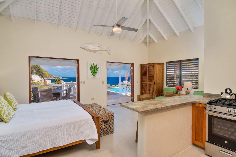Double doors open onto private pool deck
