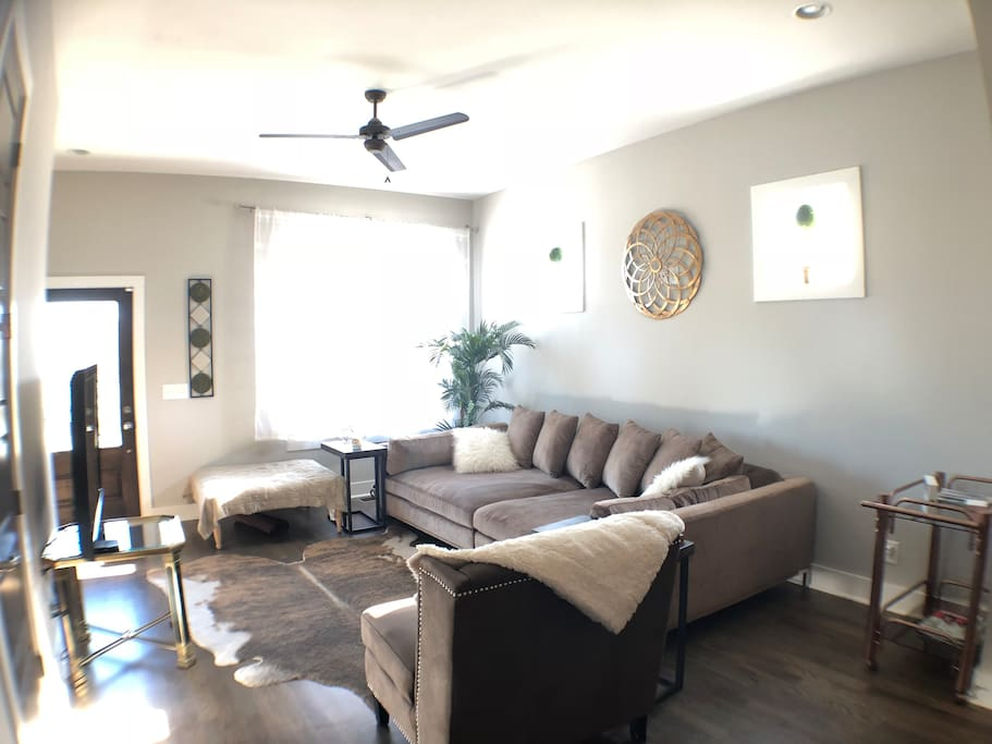 "Living room and kitchen have an open layout and perfect for groups! This couch is like a full bed at 120"" long and 60"" deep - guests give it 5 stars for sleeping!"