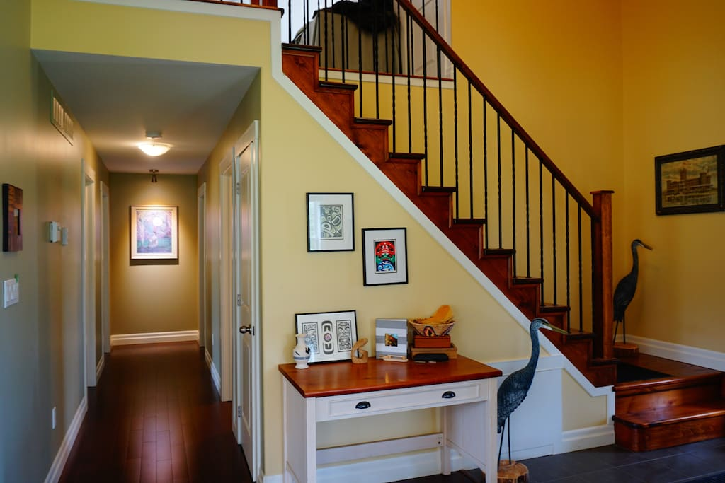 Foyer with stairwell leading to second story loft