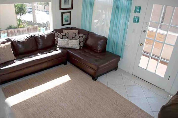Steps from beach, darling clean bright with views