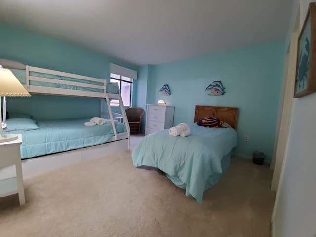 Two twin beds and one full bed, en suite bath with walk in shower.