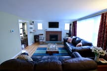 ...or just a comfortable leather couch with some colorful personal touches to gather around and relax watching movies or other football games.