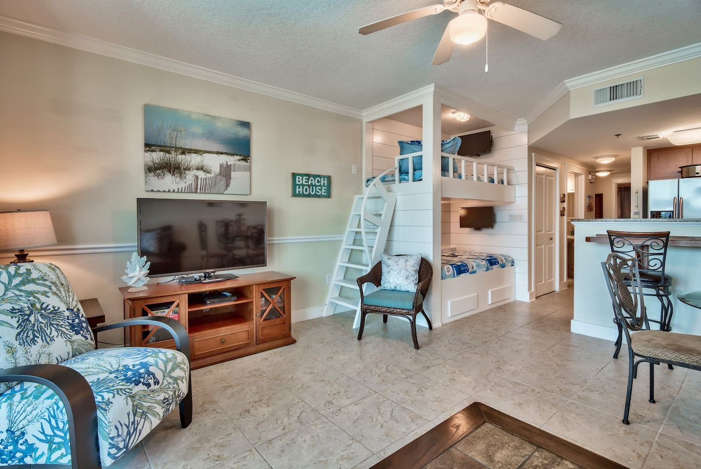 Designer bunk beds in the middle of everything. New accent chairs and furnishings. We are closed one bedroom to the beach at the Resort.
