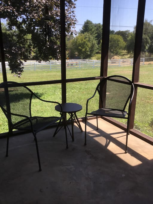 Screened in porch with views of the goats.