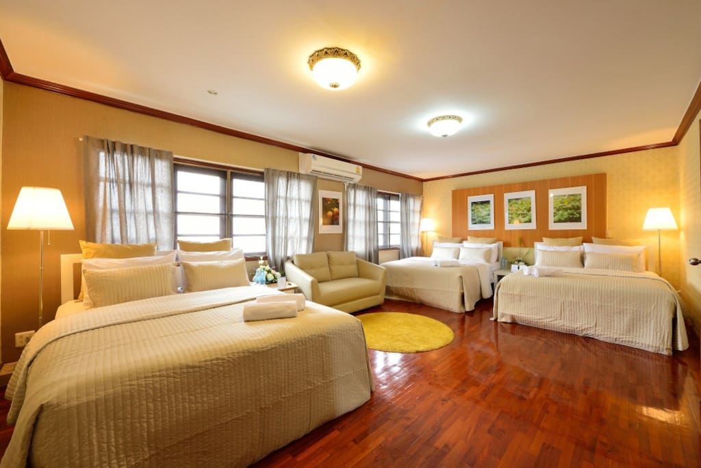 Bright and spacious bedroom with two 5' beds. Yellow is used to bring out the most entertaining scene from the room.