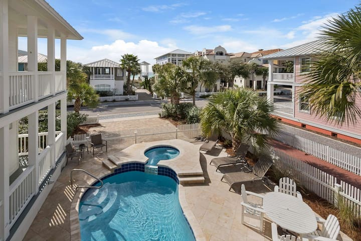 Love Shack! A beautiful carriage home w Pool/ Hot tub located directly across from beach access.