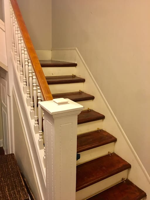 Staircase up to 2nd floor from the living room. Brazilian cherry hardwood floors throughout the house.