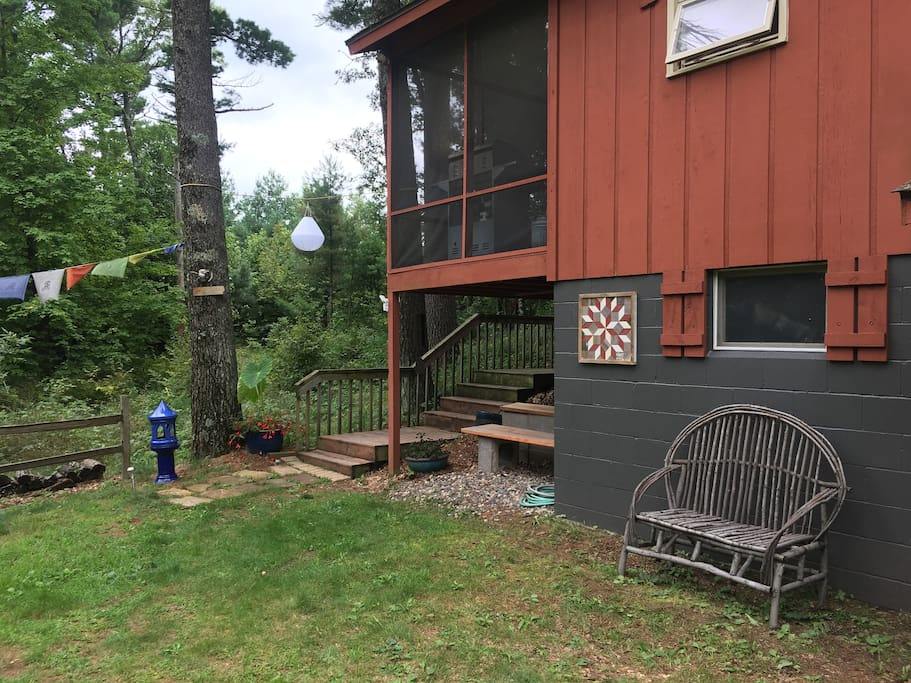 The house sits high on a ravine at the end of a long wooded driveway. It's a steep drop down to the Wood River on the other side.