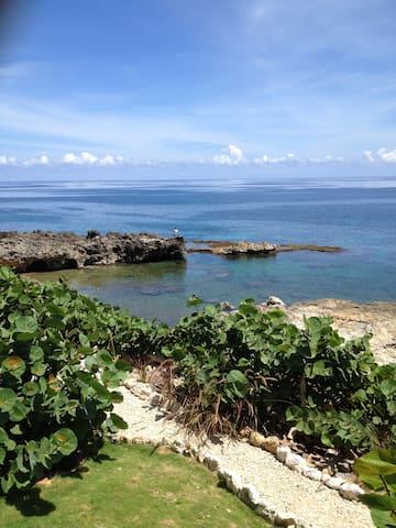 follow the pebble path below to a very private beach, the snorkeling is great so bring your gear!