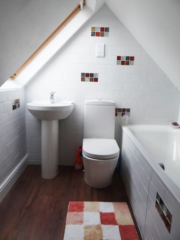 Brand new loft suite includes a bathroom on same floor with thermostatically controlled bath water, basin and toilet. There is no shower.