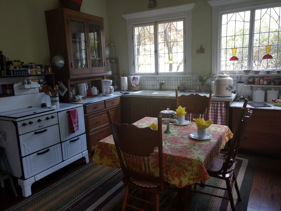Old fashioned charm in Annie's fully equipped kitchen with vintage stove, microwave, French door refrigerator and wall oven.