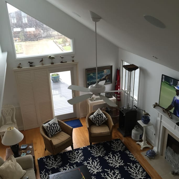 View down from the Lofted Master Suite. 2nd Floor Living area with dinning area & kitchen connected.