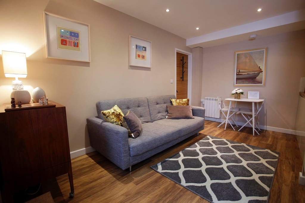 Open plan sitting room with kitchenette