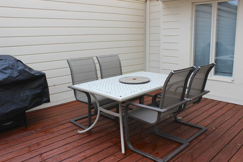 The deck has a table great for dining and a gas grill for barbequing.
