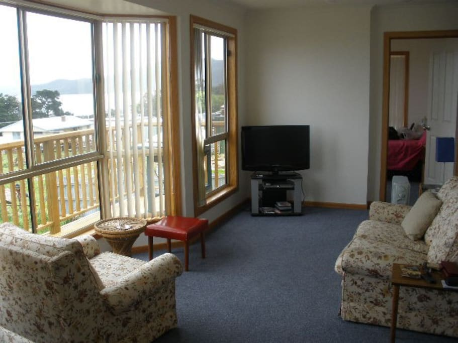 Lounge room with bay windows for northern sun and western views.