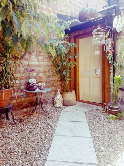 The private courtyard with private entrance leading into the cottage