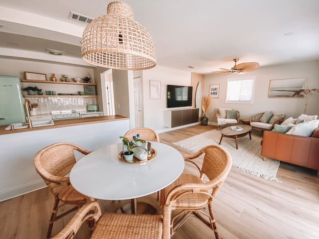 """The Family room has ample seating, a relaxing vibe, board games and a 70"""" widescreen TV."""
