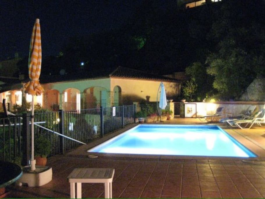 Private pool area at night