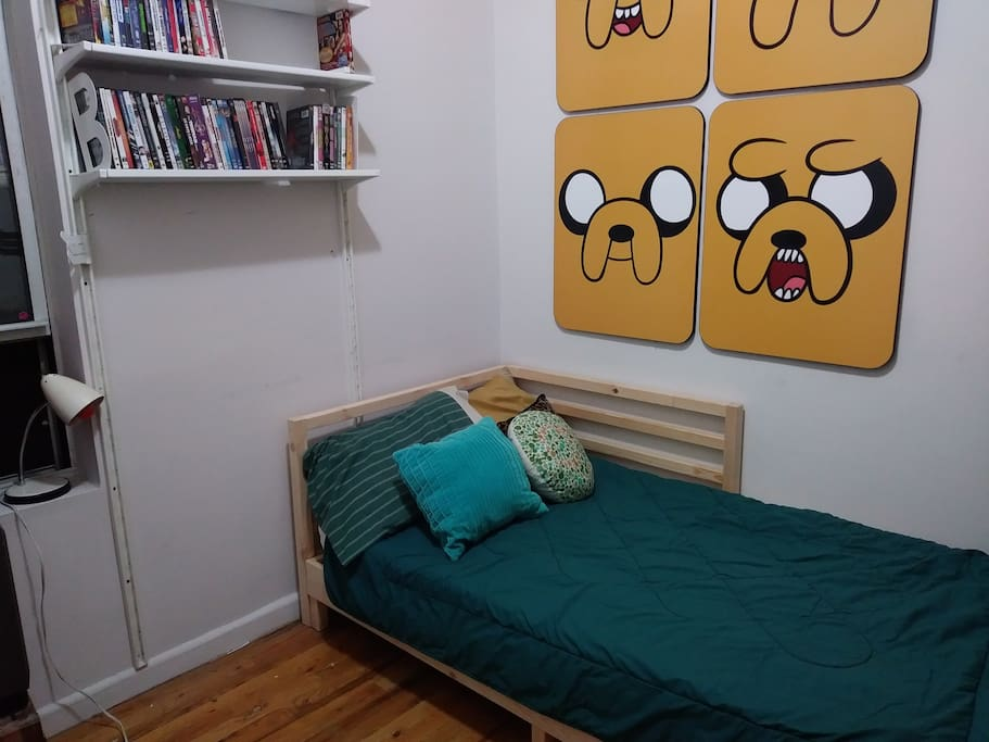 Not pictured: this twin bed pulls out into a KING. It's like wall to wall bed, but it's nice. Push it in for the space, pull it out at bedtime.
