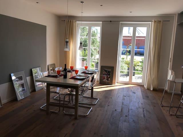 Modernes Apartment in traditionellem Bauernhaus