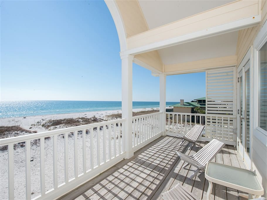 Bedrooms 3 and 4 share a spacious balcony overlooking the beach.