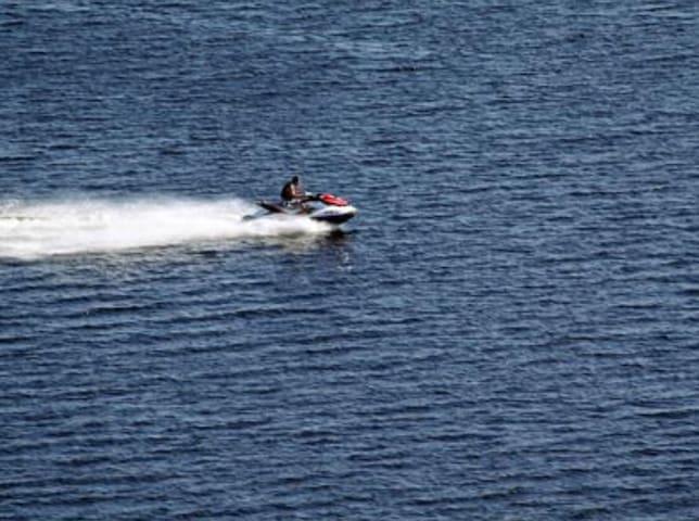 Jet skiing on Lake Bryan adjacent to the resort