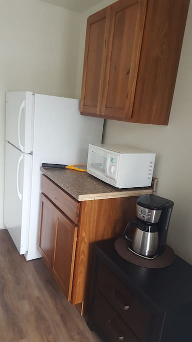 Fridge, microwave and coffee in every room