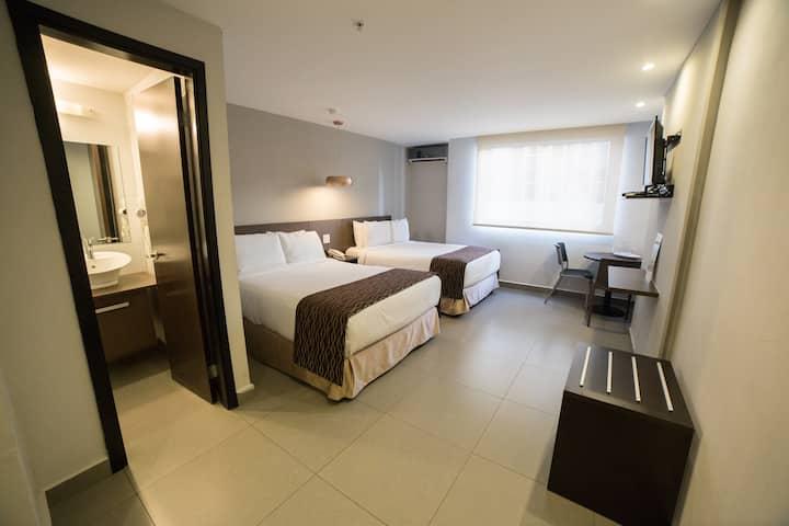 Habitación Ojos Del Rio con 2 camas dobles
