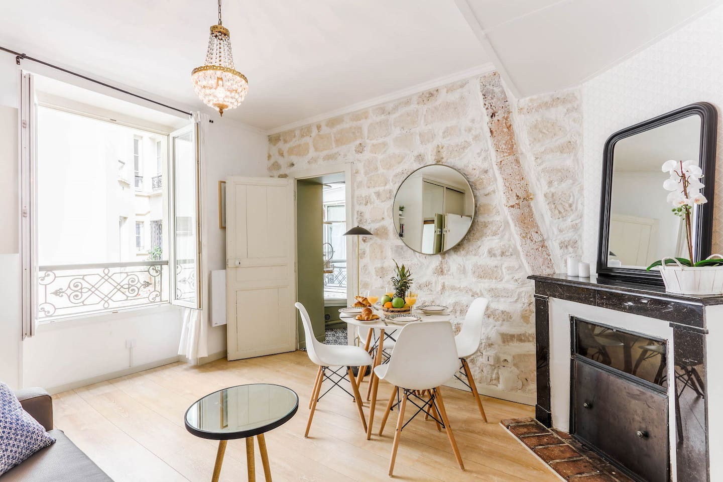 The exposed brick walls and decorative fireplace give elegance and style to the apartment.