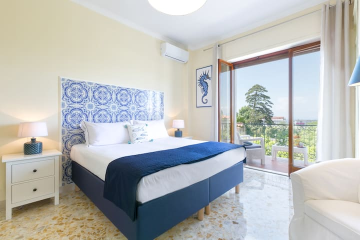 Bedroom 1 - King Bed or 2 Twin Beds, TV, AC, Wi-Fi, Storage, Balcony with Furniture