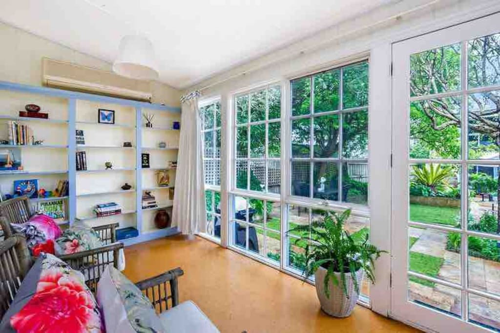 A comfy place to enjoy a coffee - one of the two Cottage sunrooms overlooking your lush furnished courtyard with Weber bbq.  Browse the sunroom local history book collection, and for the kids we offer a selection of toys and books.