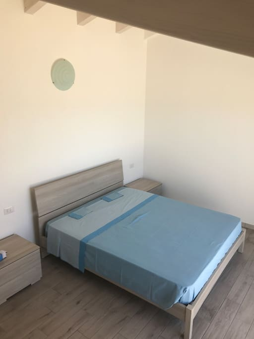 upstairs bedroom in front of the sea