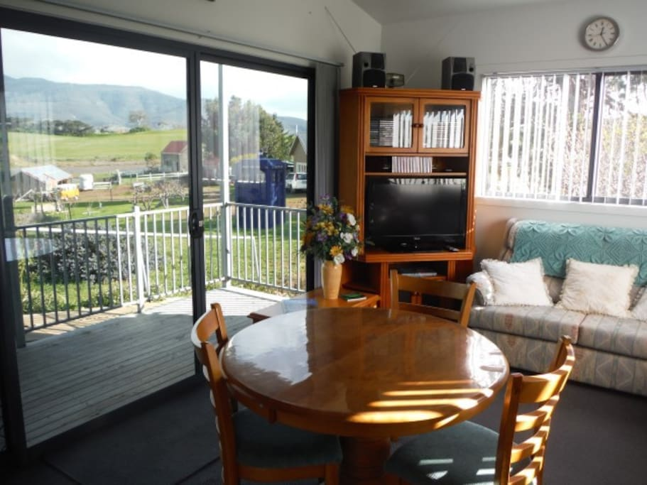 The open plan living area has views over horse paddocks, small vineyard and orchard.