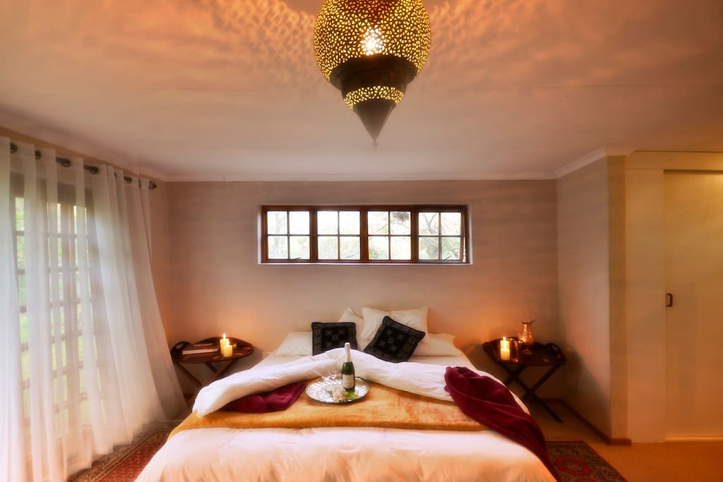 Delightful Main Bedroom with en suite jacuzzi bath shower and cast iron tub.