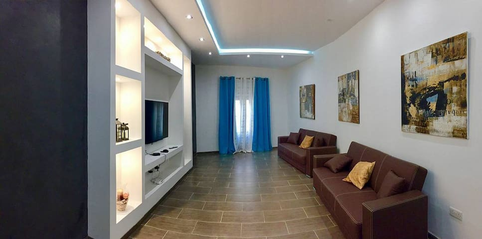 Living Area with a/c and 2 sofa bed sleep 4 person