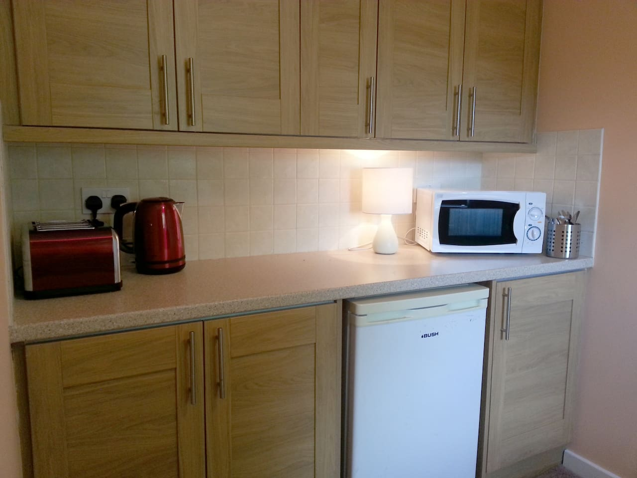 Kitchenette equipped with microwave, fridge, kettle and toaster