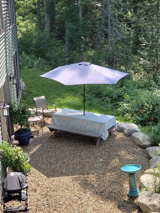 Patio with picnic table, umbrella, chairs and gas grill.  Your own organic tomatoes in the blue planters at each side of your entrance door.  Birdbath and feeder, if you like to watch the birds.  I'll fill each day or you can if you  prefer.