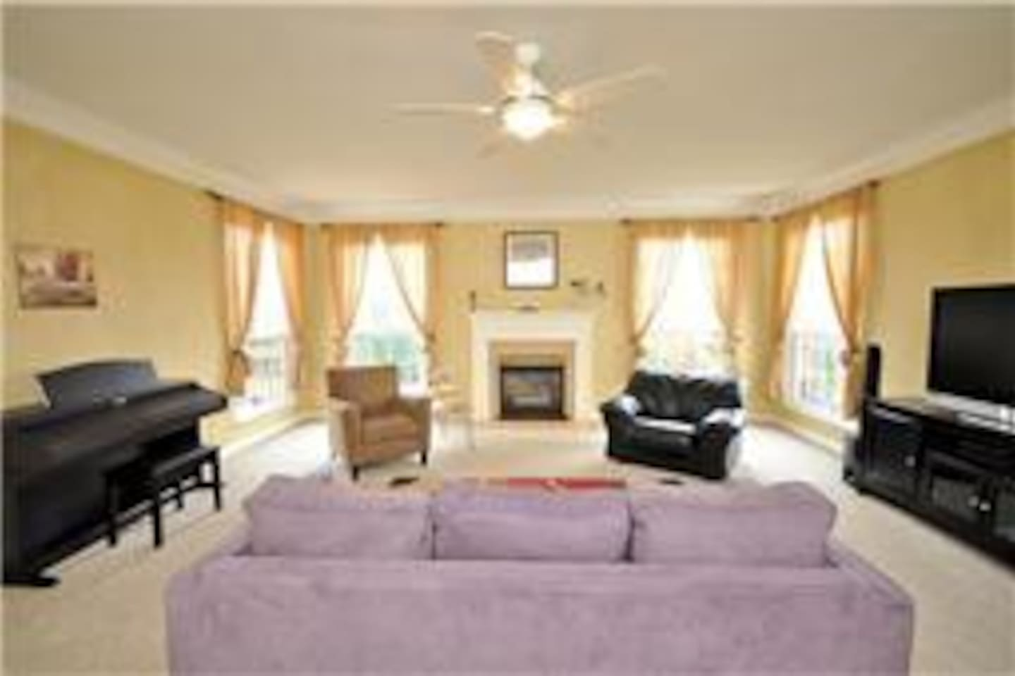 Feel at home in large living area with smart tv, dvd, and piano