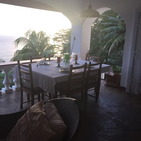Guests can enjoy  the lovely sea view and admire the beautiful nature while enjoying a meal under the veranda.