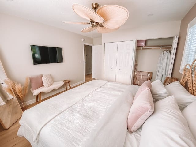 Master Bedroom including two housecoats, Beach Chairs, Beach Umbrella, Beach Cooler,  Yoga Matts, Yoga Block and Yoga Mat cleansing spray.