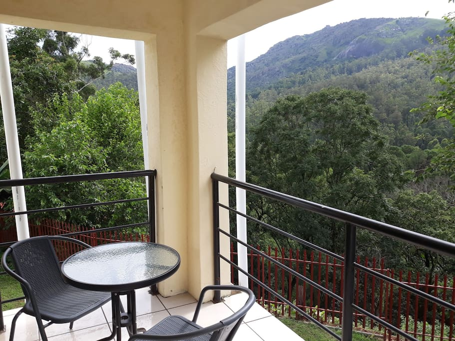 Balcony accessible through main bedroom, with beautiful scenery of mountain and plantations