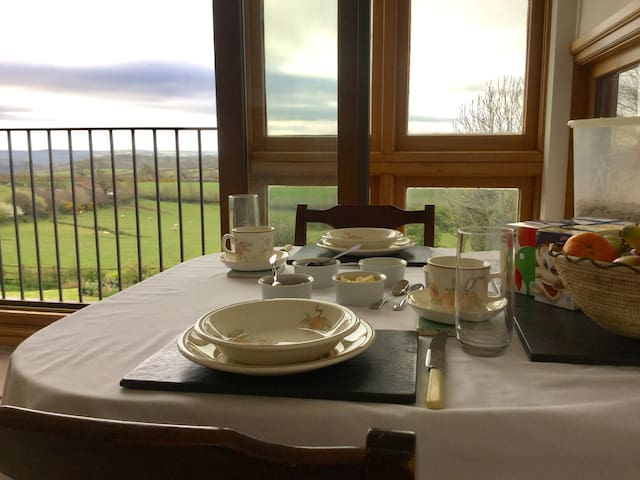 Panoramic views over country side from breakfast/sitting room.