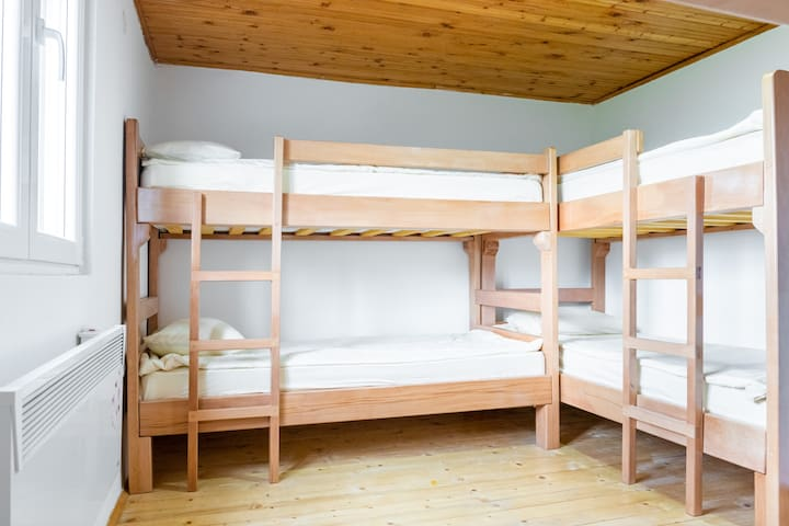 The room itself is suitable for up to 6 people. There are bunk beds and very few decorations inside the room.