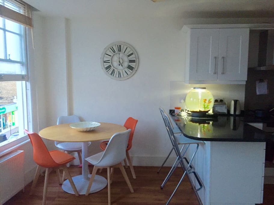Dining area and breakfast bar - more seats available from storage