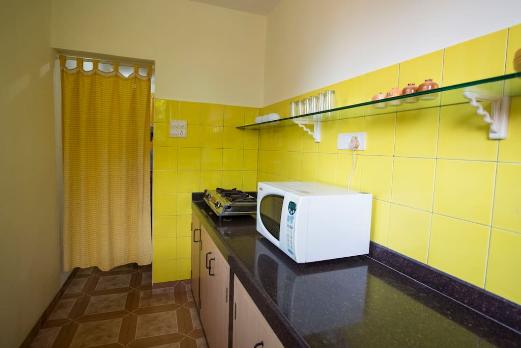 The 1 BHK kitchen with all amenities  for Guest who like home cooked food .