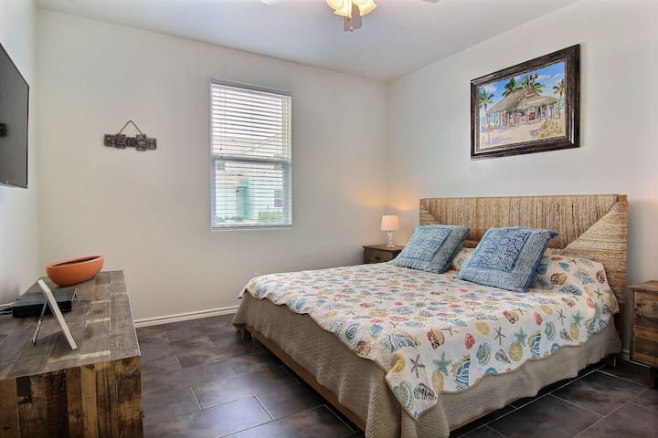 Downstairs fully furnished master bedroom with King bed.  Closet contains a portable queen sized bed.
