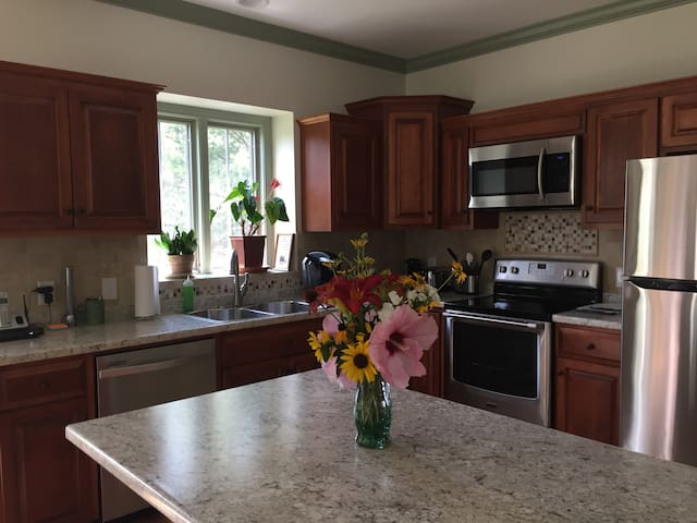 Kitchen and island with all the gadgets, dishwasher, large 2 bowl sinks and full stainless refrigerator, microwave and 2 coffee makers, tea maker!  A separate kitchen table that expands for six.