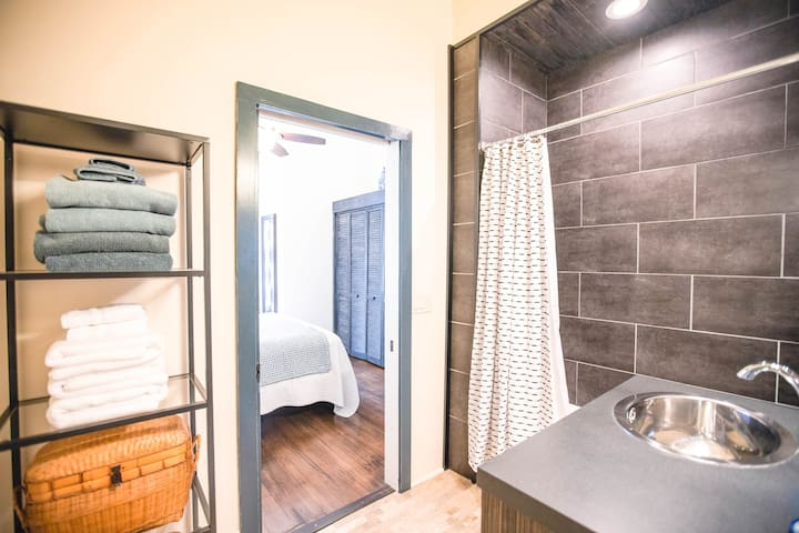 Master bath with shower and tub. Additional half bath off the living room.