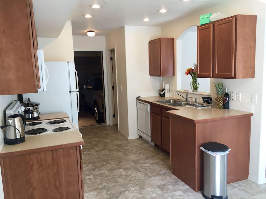 Spacious clean Kitchen. Leads to garage. Use of garage seasonal. Ask upon booking.
